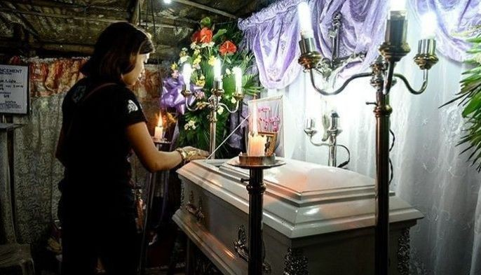 The mother views the coffin of her three-year-old baby Kateleen Myca Ulpina, killed during a sting operation conducted by the police, is seen during her wake in Rodriguez, Rizal, east of Manila on July 5, 2019.