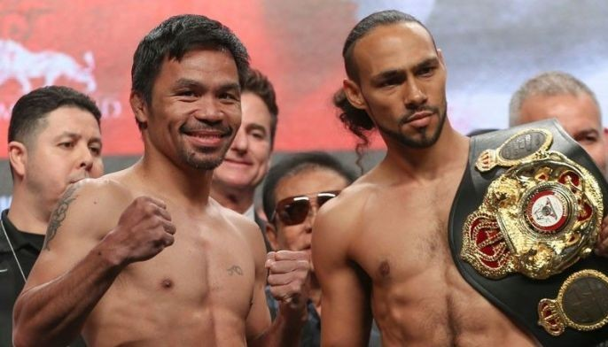 Manny Pacquiao and Keith Thurman pose after making weight Friday at the MGM Grand Garden Arena in Las Vegas.