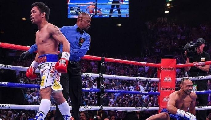 LAS VEGAS - JULY 20: Manny Pacquiao is sent to his neutral corner after knocking down Keith Thurman in the first round of their fight during the FOX Sports PBC Pay-Per-View and PBC on Fox Fight Night at the MGM Grand Garden Arena on July 20, 2019 in Las Vegas, Nevada