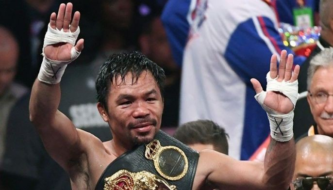 Manny Pacquiao celebrates his split-decision victory over Keith Thurman in their WBA welterweight title fight at MGM Grand Garden Arena on July 20, 2019 in Las Vegas, Nevada.
