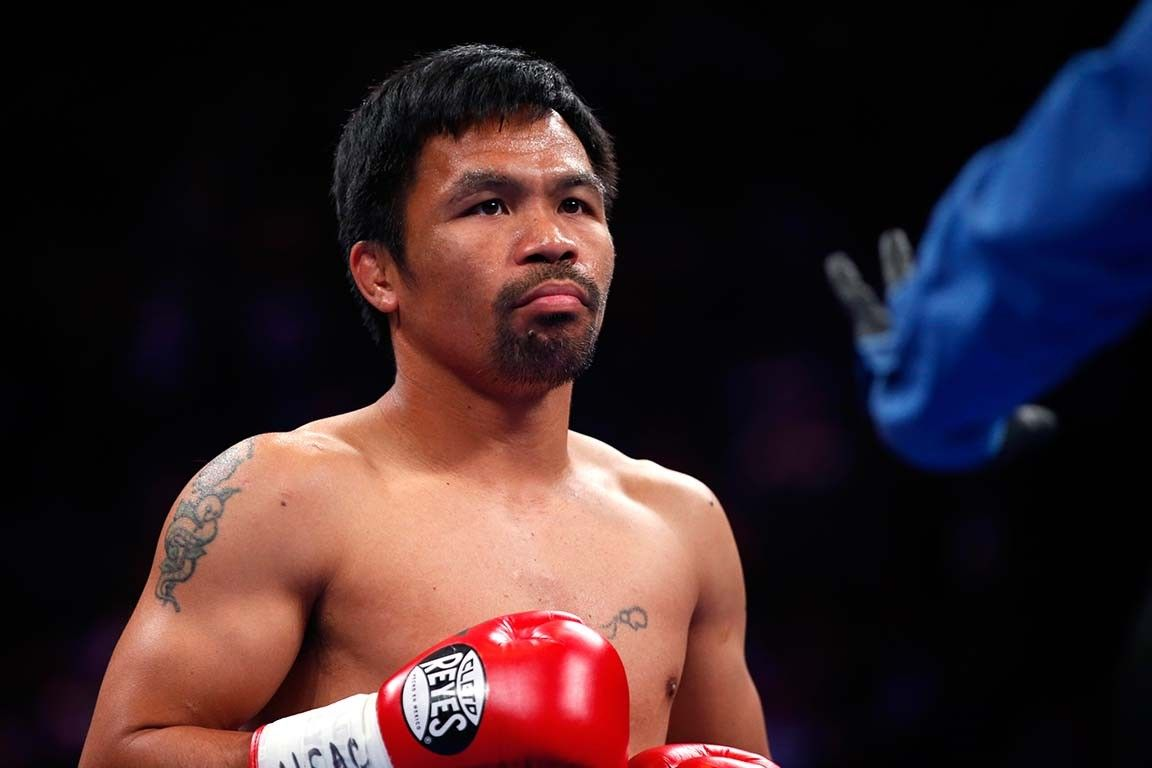 Pacquiao hits back after Mayweather post, poses rematch challenge