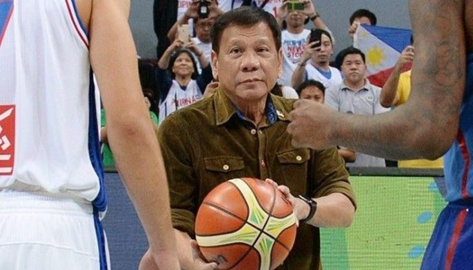 President Duterte prepares to toss the ball during the 2016 FIBA Olympic men�s qualifying basketball tournament between the Philippines and France at the MOA Arena on July 5, 2016.