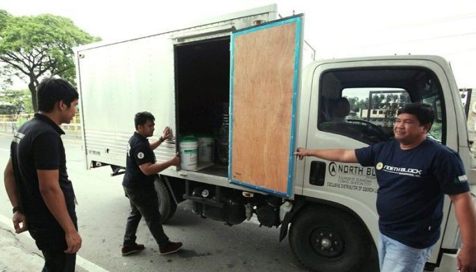 Members of the Quezon City Veterinary Inspection Service inspect a delivery van at the Batasan Road near the boundary of San Mateo, Rizal to prevent the entry of pork suspected to be infected with African swine fever.