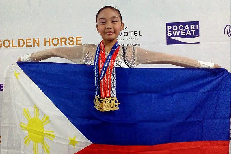 Young Pinay brings home ice skate gold
