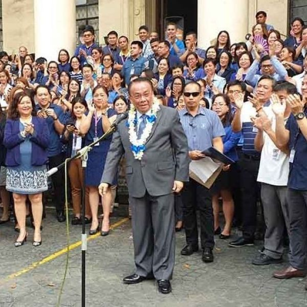 Chief Justice Lucas Bersamin thanks Supreme Court officials and employees as he bids them goodbye during his last flag-raising ceremony as the country's 25th chief magistrate at the SC courtyard in Manila, Oct. 14, 2019.
