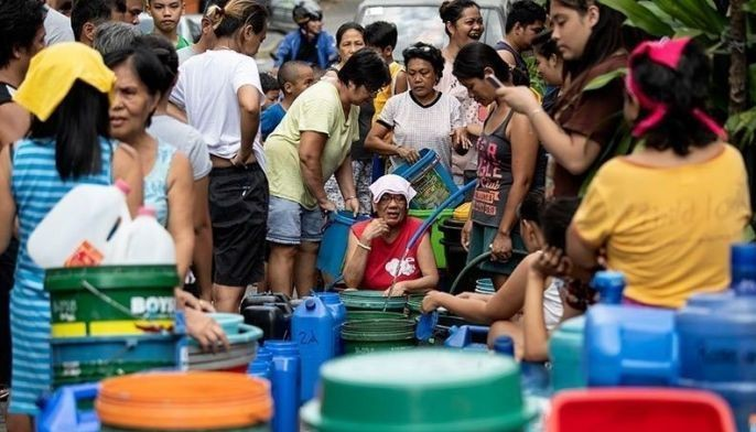 This photo taken on March 14, 2019 shows residents of Barangka in Manila, gathering water. Manila has been hit by its worst water shortage in years, leaving bucket-bearing families to wait hours for a fill up from tanker trucks and some hospitals to turn away less urgent cases.
