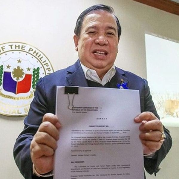 Sen. Richard Gordon shows a copy of the preliminary report on �ninja cops� at the Senate yesterday.