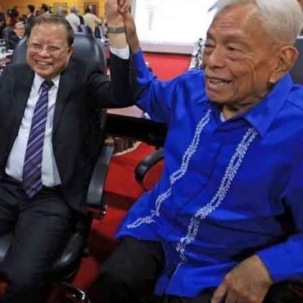 In this file photo from July 2018, Pimentel Jr. (right), considered the father of federalism, shares a light moment with retired Supreme Court associate justice Antonio Nachura and ex-chief justice Reynato Puno after signing the draft charter for the proposed federal system of government at the PICC.