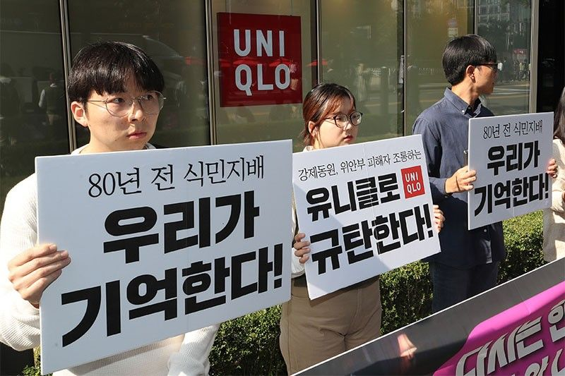 Japan's Uniqlo pulls ad after South Korean fury