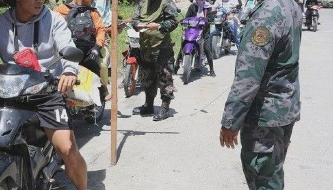 Personnel of the Cotabato City police office screen motorists at a checkpoint into the city from Datu Odin Sinsuat town in Maguindanao.