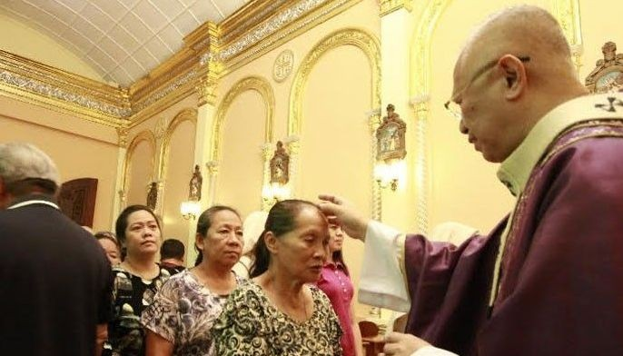 Photo from The Freeman shows Archbishop Jose Palma of the Archdiocese of Cebu marking the forehead of a parishioner during an Ash Wednesday mass.
