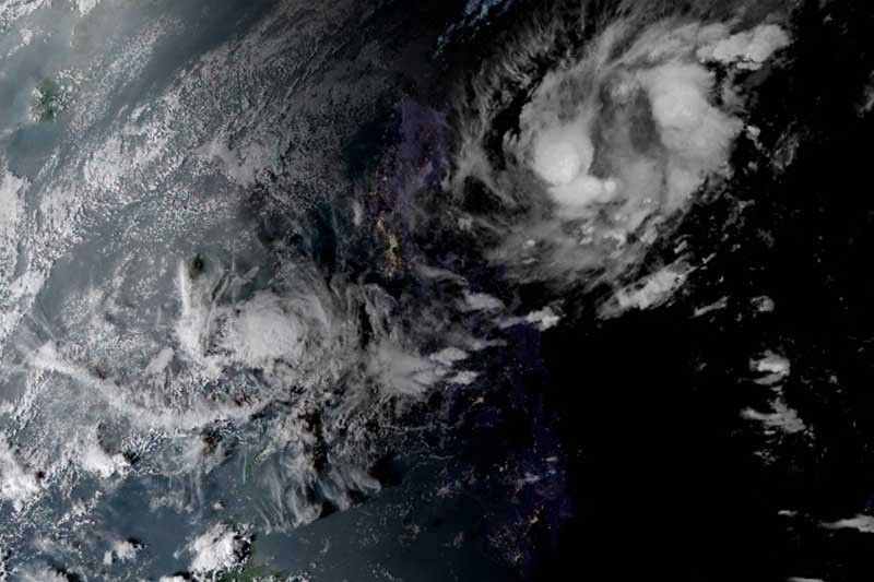 Slow-moving Tropical Storm Ramon hovering over Philippine Sea