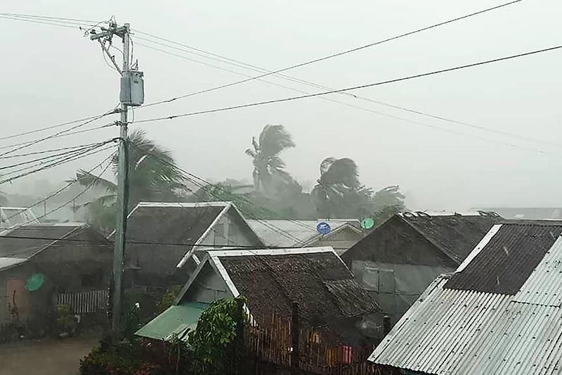 Bringing heavy rains and violent winds, Typhoon Tisoy tears through southern Luzon