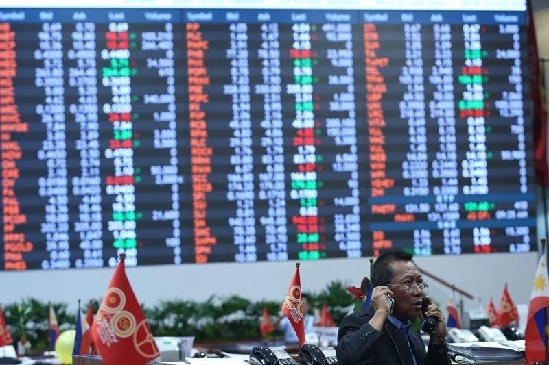 PSEi ends year lower on late profit taking