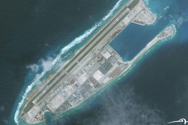 With world busy fighting coronavirus, China quietly builds installations on Philippine-claimed reefs