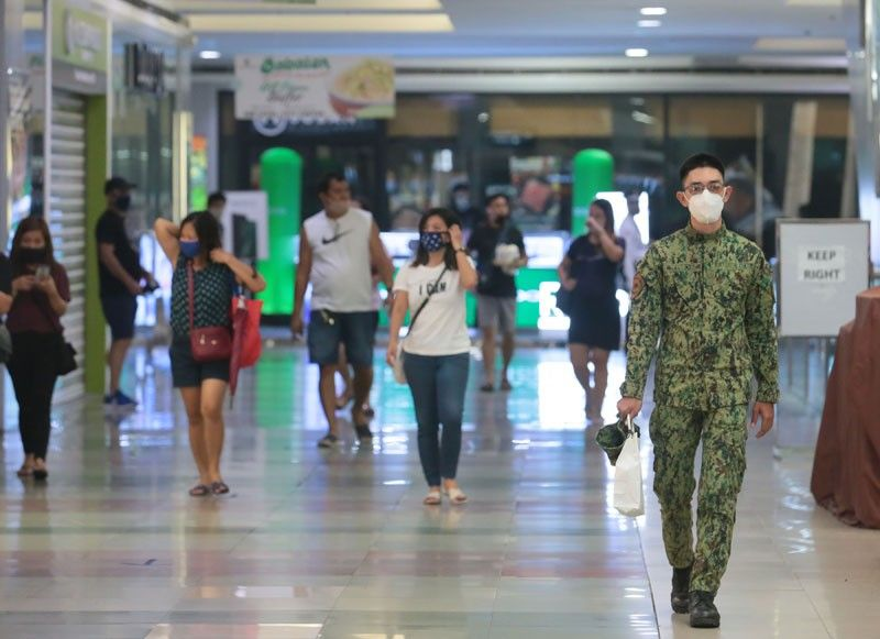 People flock to malls, markets as virus lockdown eased