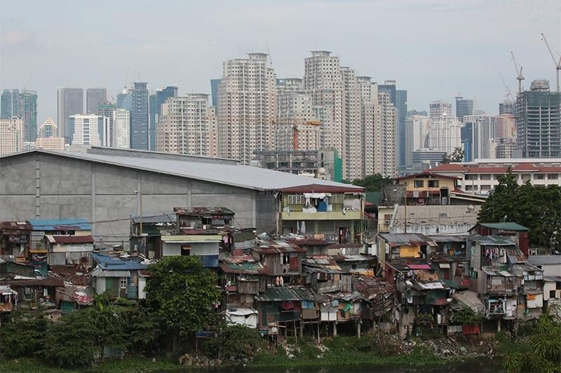 Beyond Manila Bay, measly housing budget leaves nothing for slum residents