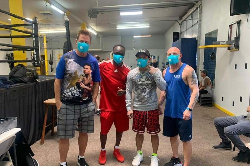 Boxers champion face masks under 'new normal'