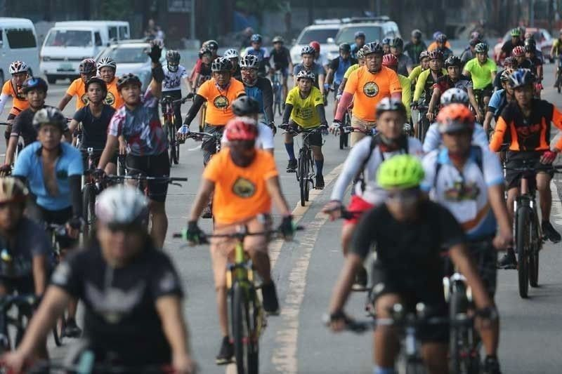 Quezon City to lower fines for �no bike helmet� policy