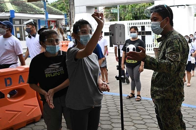 Philippines 'not yet out of the woods' of pandemic, DOH says