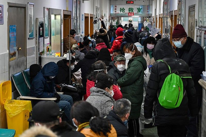 WHO to probe virus origins in China as nations struggle with surges