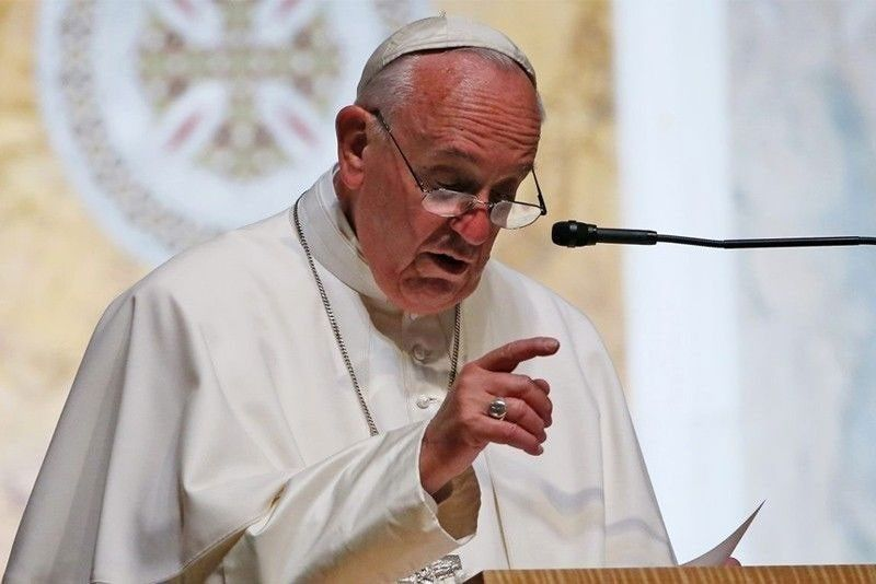 Pope urges Philippines: Be a home with open doors