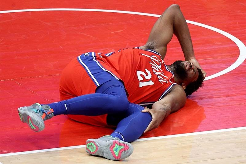 Sixers top Wizards as Embiid is injured; Nuggets beat Grizzlies
