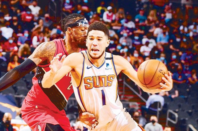 Suns stay in hunt for top spot; Heat stall Sixers in the East