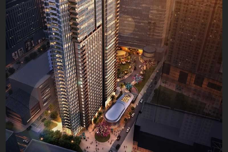 Phase 2 underway: CLI tops off first towerof high-end condo project