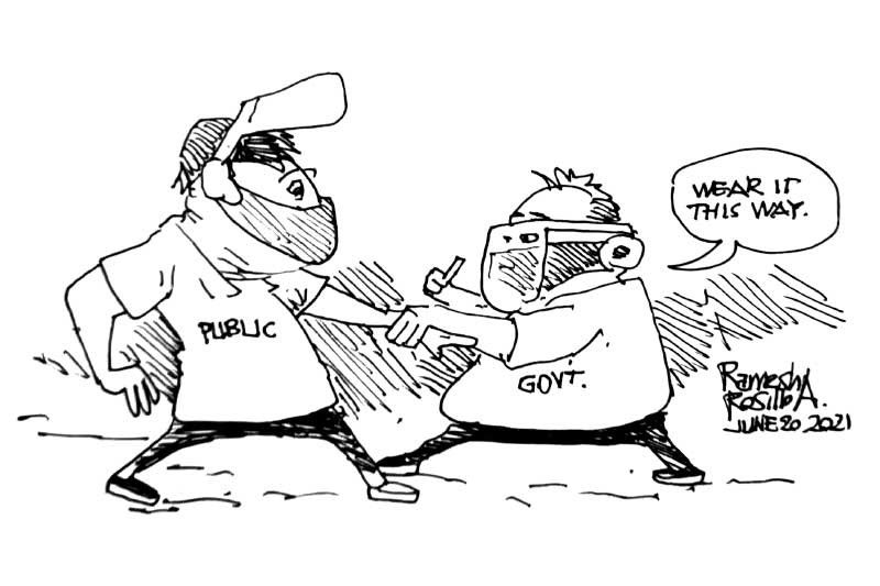 EDITORIAL - It is people who make face shields useless