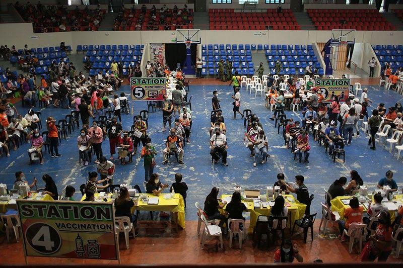 Metro Manila cities limit vaccination amid insufficient supply