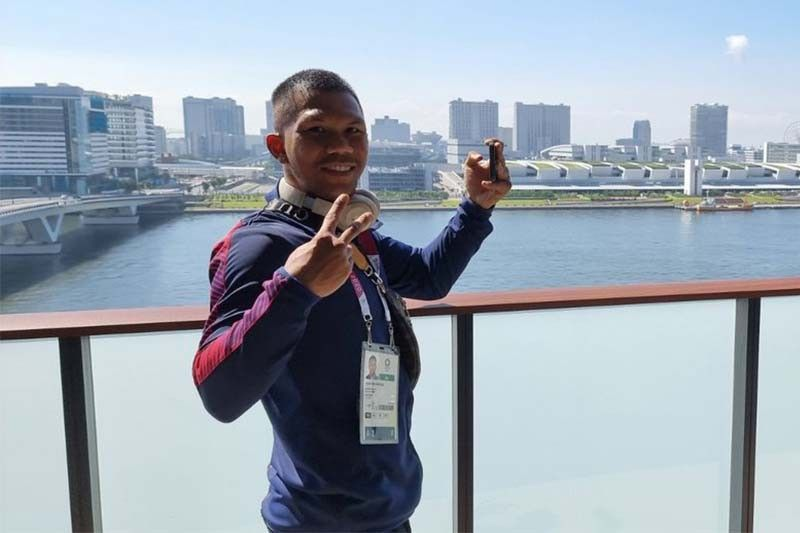 Marcial finally reunited with boxing teammates in Tokyo for Olympics