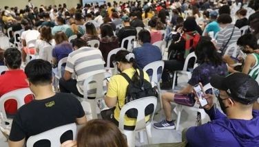 Mandaluyong residents are seen in this July 14, 2021 photo waiting to get their COVID-19 vaccine at a mall