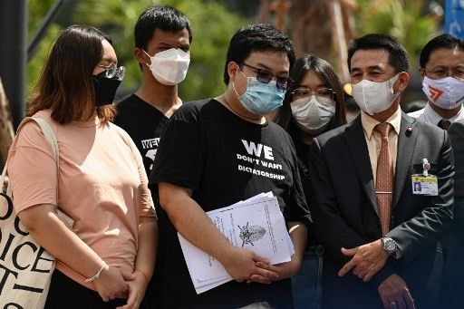 Dozen Thai student activists charged with royal defamation