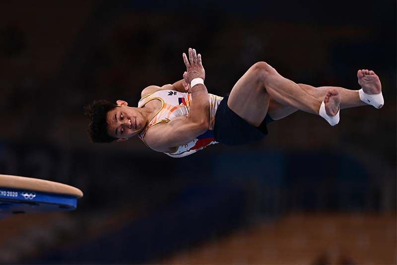 Yulo averts total Olympic disaster, makes it to vault finals