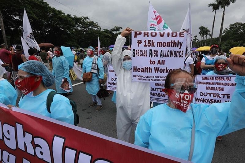 Protesters urged to follow health rules as Delta variant treat looms