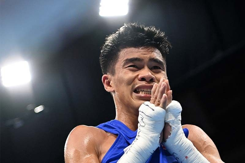 Goodbye reigning champ, hello another Olympic medal: Paalam beats Uzbek to enter boxing semis