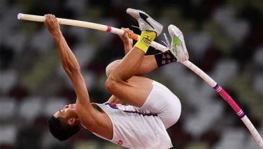 Philippines' Ernest John Obiena competes in the men's pole vault final during the Tokyo 2020 Olympic Games at the Olympic Stadium in Tokyo on August 3, 2021.