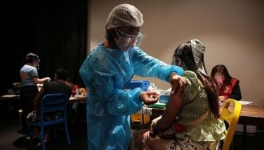 Non-San Juan residents receive their first dose of COVID-19 vaccine at the Theater Mall in San Juan City on Sept. 14, 2021.