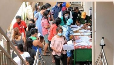 At least 700 market vendors line-up to receive their first dose of the Sinovac COVID-19 vaccine at the Bayombong public market in Bayombong, Nueva Vizcaya on Sept. 6, 2021.